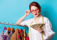 Young redhead designer with dollars Stock Image