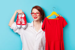 Young redhead designer with dress and gumshoes Royalty Free Stock Images