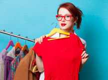 Young redhead designer with dress Royalty Free Stock Photo