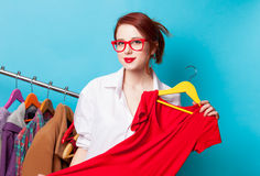 Young redhead designer with dress Stock Photos