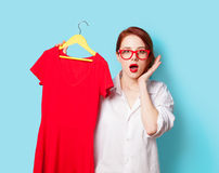 Young redhead designer with red dress Stock Image