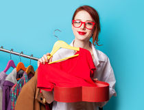 Young redhead designer with red dress Stock Photos