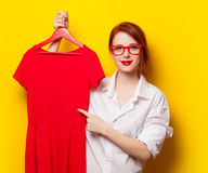 Young redhead designer with red dress Royalty Free Stock Images