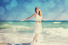 Young redhead girl at the beach. Stock Photos