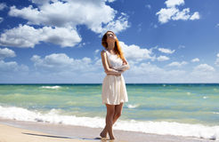 Young redhead girl at the beach. Stock Image
