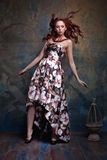 Young Redhead girl in a beautiful dress Stock Photography