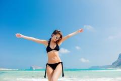 Young redhead girl in black bikini on Balos beach. West Crete, Greece. Summertime season vacation, July stock photo