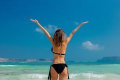 Young redhead girl in black bikini on Balos beach. West Crete, Greece. Summertime season vacation, July royalty free stock images