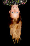 Young redhead girl hanging upside down Royalty Free Stock Photo