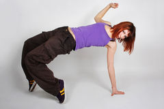 Young redhead girl in hip-hop clothes dancing Royalty Free Stock Photography
