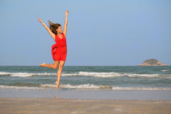 Young redhead girl jumping Stock Images