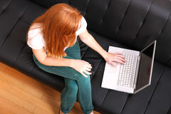 Young Redhead Girl with a Laptop Royalty Free Stock Photography
