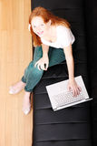 Young Redhead Girl with a Laptop Royalty Free Stock Photos