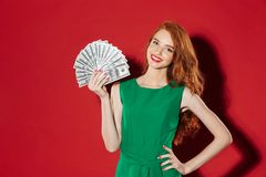 Young redhead girl with money Stock Photo
