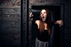 A young redhead girl shouting Royalty Free Stock Image