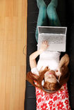 Young Redhead Girl surfing on the Sofa Royalty Free Stock Photo