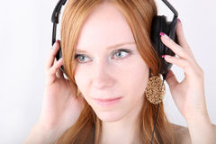 Young redhead with headphones Stock Image