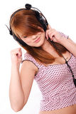 Young redhead with headphones Royalty Free Stock Image