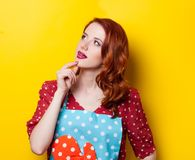 Young redhead housewife with gloves Stock Photos