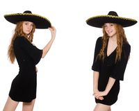 The young redhead lady in black dress with black sombrero. Young redhead lady in black dress with black sombrero royalty free stock photography