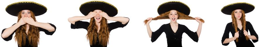 The young redhead lady in black dress with black sombrero. Young redhead lady in black dress with black sombrero royalty free stock image