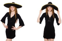 The young redhead lady in black dress with black sombrero. Young redhead lady in black dress with black sombrero royalty free stock images