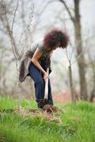 Young redhead lady gardening Stock Photos