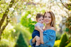 Mother and child have a lasure in garden Stock Photography