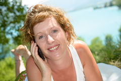 Young redhead phone Royalty Free Stock Image
