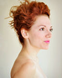 Young redhead with punky hair and tragus piercing Royalty Free Stock Photos