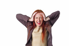 Young redhead screaming business woman with headache Royalty Free Stock Images