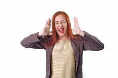 Young redhead screaming business woman with headache Royalty Free Stock Photography