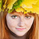 Young redhead teenager woman in a wreath Stock Photo