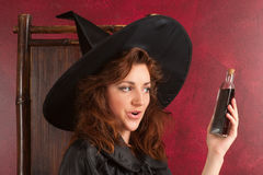 Young redhead witch with potions Stock Photo