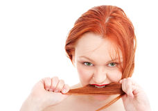Young redhead woman biting her hair Stock Photos