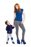 Young redhead woman with boy Stock Photos