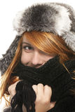 Young redhead woman covering in muffler Royalty Free Stock Photography
