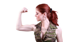 Young redhead woman flexing biceps Stock Photos