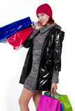 Young redhead woman goes holiday shopping Stock Photography