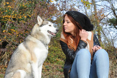 Young redhead woman and her wolfhound Stock Photography