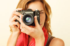 Young redhead woman looking through viewfinder Royalty Free Stock Photo