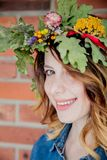 Young redhead woman with oak leaves wreath royalty free stock photography