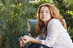 Young redhead woman outdoors Royalty Free Stock Image