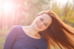 Young redhead woman in the park Royalty Free Stock Images