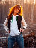 Young redhead woman. In the park stock photo