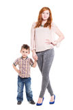 Young redhead woman posing with her little son Royalty Free Stock Images
