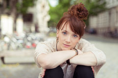 Young redhead woman staring intently at the camera Royalty Free Stock Images