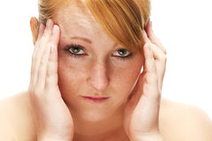 Young redhead woman suffering on headache Royalty Free Stock Photos