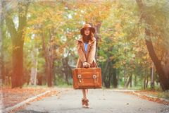 Young redhead woman with suitcase Royalty Free Stock Photography