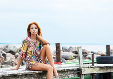 Young redhead woman in a summer dress on a vacation Royalty Free Stock Photos